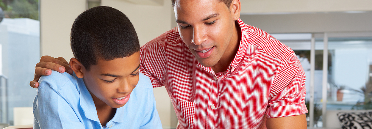 African American father and son in home