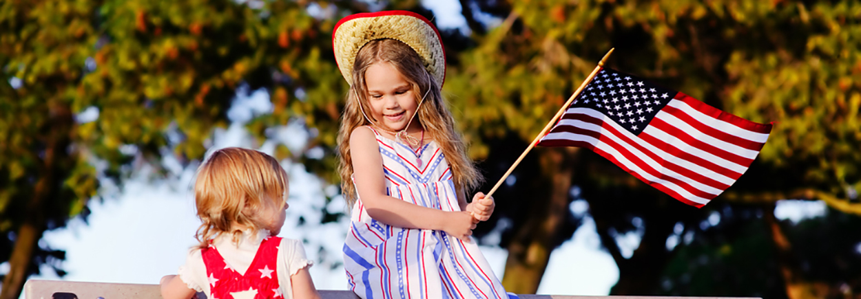 Children playing with American flag
