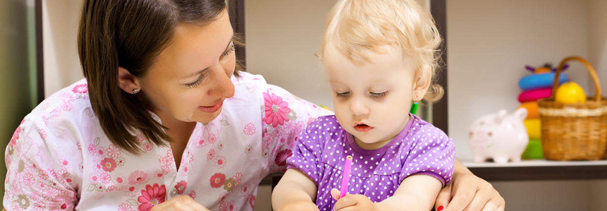 Nurse with a toddler coloring